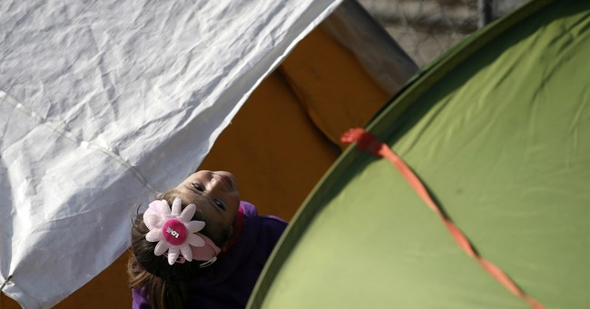 The Latest: Turkey says it will abide by refugee rules
