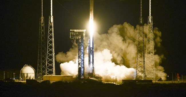 Space station cargo launches by light of nearly full moon