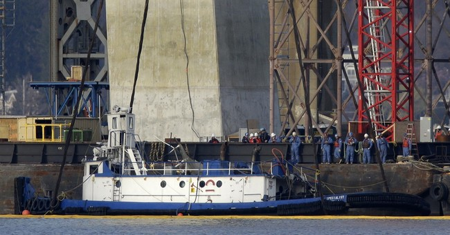 Body of crewman pulled from sunken tugboat as family watches