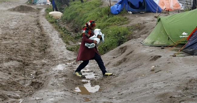 The Latest: Protest on Lesbos against migrant detentions