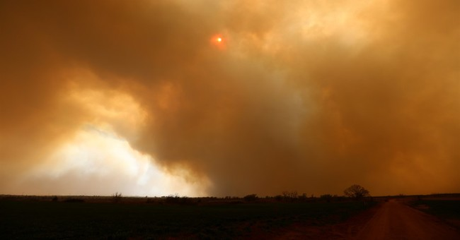 The Latest: Winds frustrate wildfire containment in Oklahoma