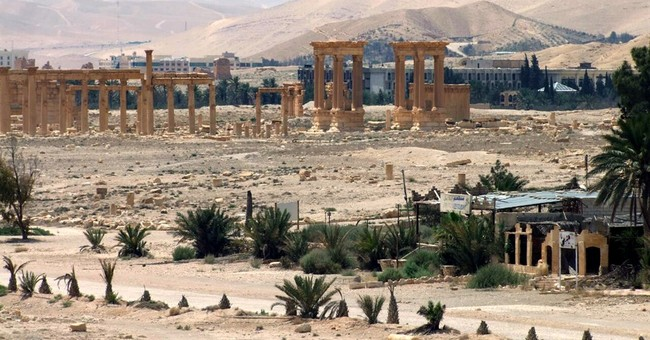 The Latest: Russian officer killed near Palmyra in Syria