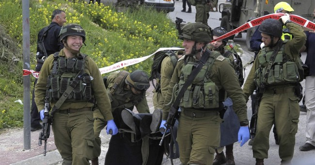 Israel detains soldier seen shooting Palestinian on ground