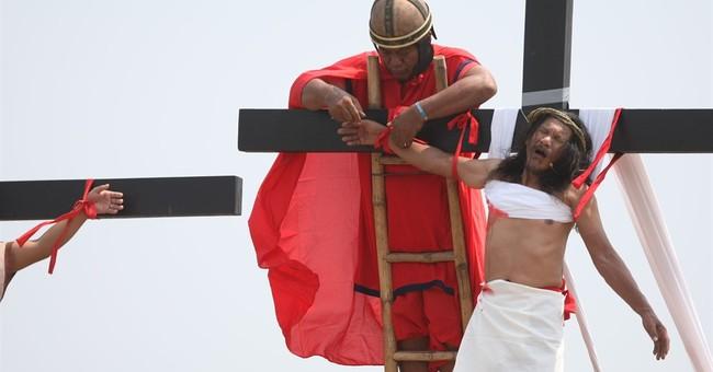 Filipino nailed to cross prays for Belgium, Philippines