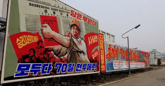 AP PHOTOS: North Koreans hunker down in loyalty campaign
