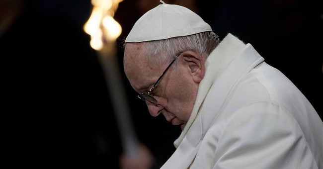 Pope on Good Friday decries terror profaning God's name