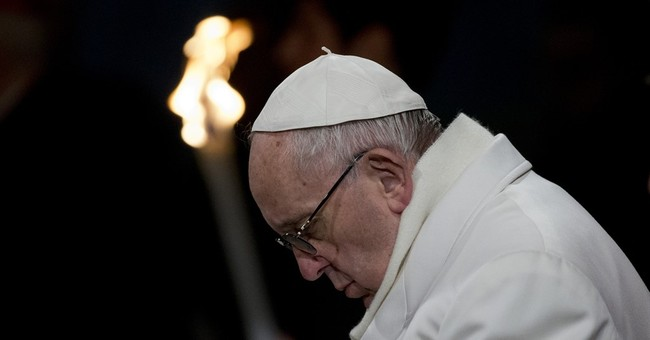 Pope on Good Friday decries terror profaning God's name