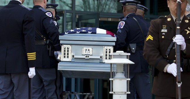 Funeral honors Maryland officer killed outside station