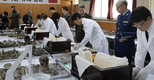 Image of Asia: Preparing Korean War remains to return home