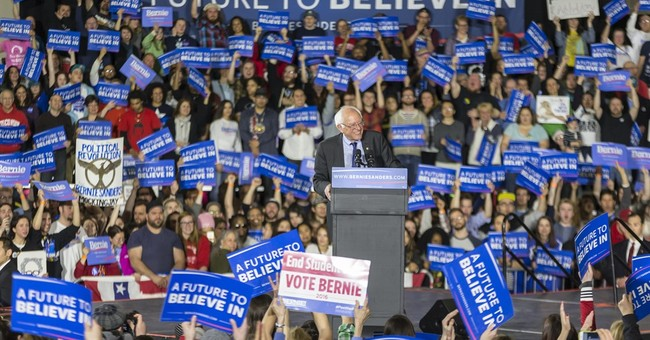 With echoes of 2008, Sanders vows to fight as path narrows