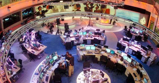 Al-Jazeera to slash 500 jobs, many in its Qatar headquarters