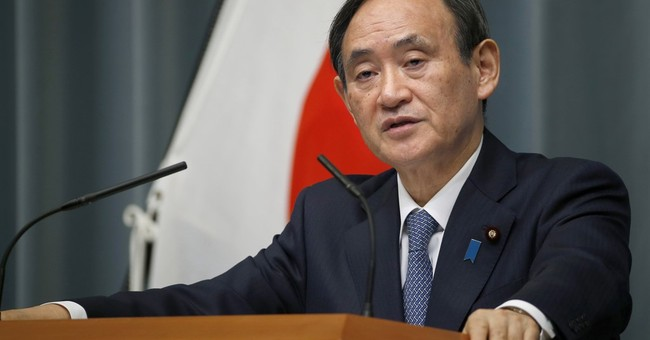 Japan sticks to non-nuclear arms pledge after Trump remark