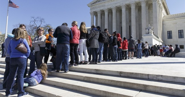 Tied 4-4 after Scalia's death, high court gives unions a win