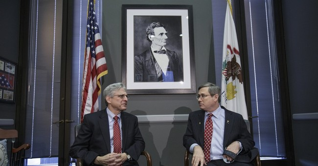 Garland holds first meeting with GOP senator, Kirk of Ill.