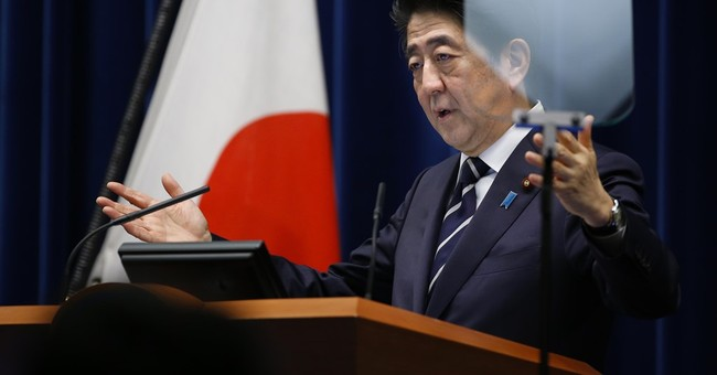 Japan's Abe says no plans to postpone consumption tax hike
