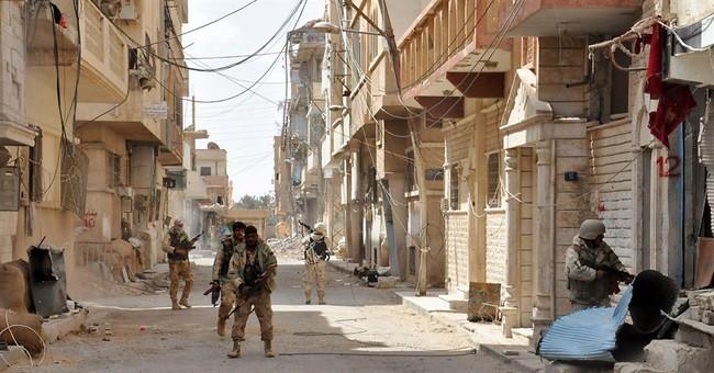 Syria's Assad tries to polish image with Palmyra's recapture
