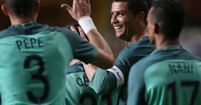 Portugal beats Belgium 2-1 in 1st game after Brussels attack