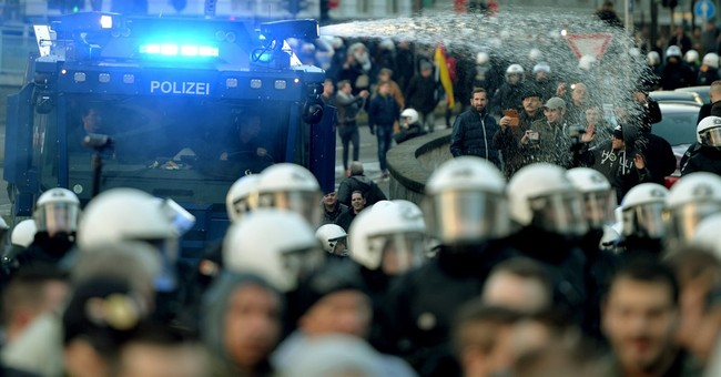 Protests in Cologne after assaults; Merkel pledges new laws