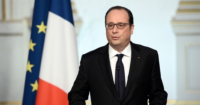 The Latest: Paris suspect charged with terrorism offenses