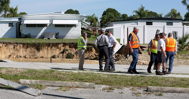60-foot hole opens in Florida trailer park