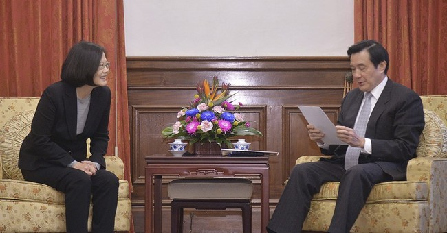 Taiwan's outgoing leader, successor pledge smooth transition