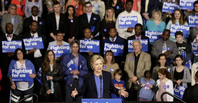 Clinton faces disruptive Sanders supporters in New York