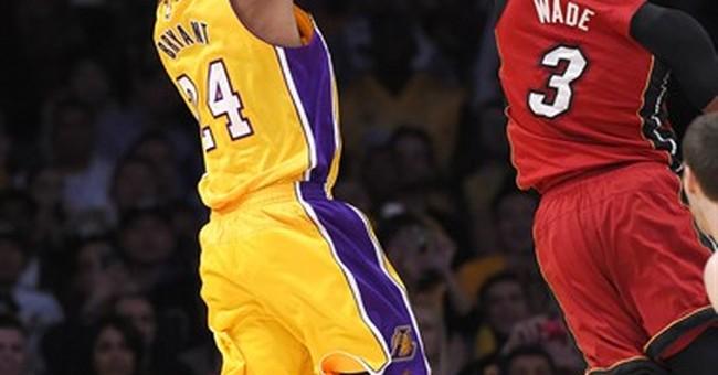 Randle hits big shot in Lakers' 102-100 OT win over Heat