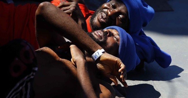 AP PHOTOS:  European navy ship rescues migrants off Libya