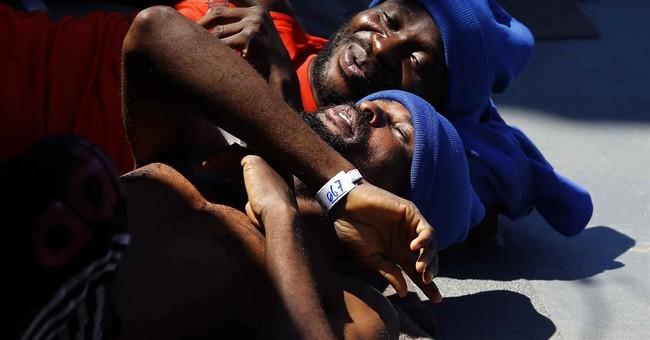 AP PHOTOS:  European navy ship rescues migrants off Libya