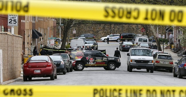 2 armed men fatally shot after Baltimore police open fire