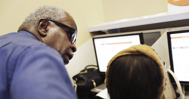 US applications for jobless aid rise, but still near lows