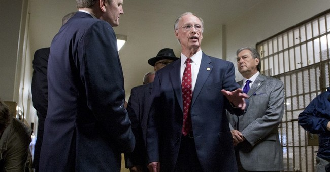 Alabama governor trudges on in the face of scandal questions