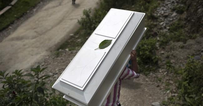Peru returns remains of 40 farmers killed by Shining Path