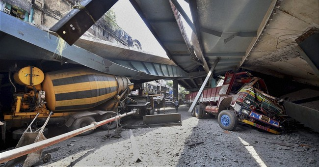 Rescuers search debris in Indian overpass collapse, 22 dead