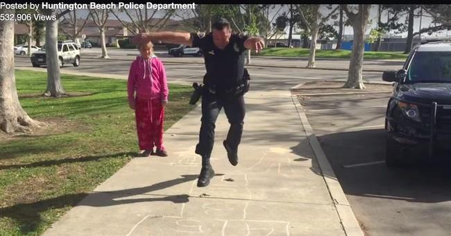 Hopscotch cop: Officer jumps to help homeless girl