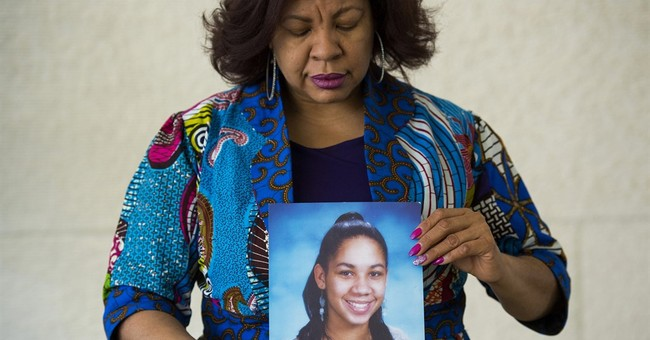Armed with photo of slain daughter, mom pushes for change