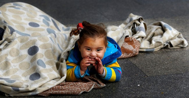 AP PHOTOS: Syria refugees beg for a living on Beirut streets