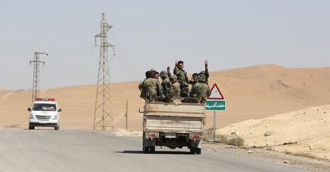 The Latest: Strike kills leader of al-Qaida faction in Syria