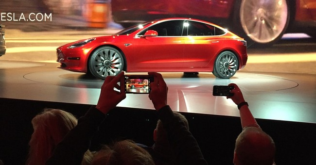 Orders for lower-price Tesla reach 325,000