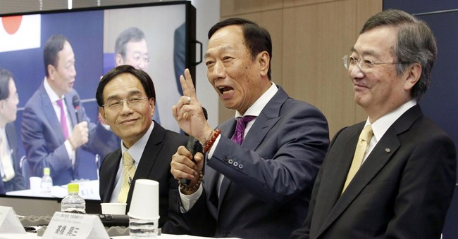 Foxconn's head pledges turnaround at Sharp after takeover