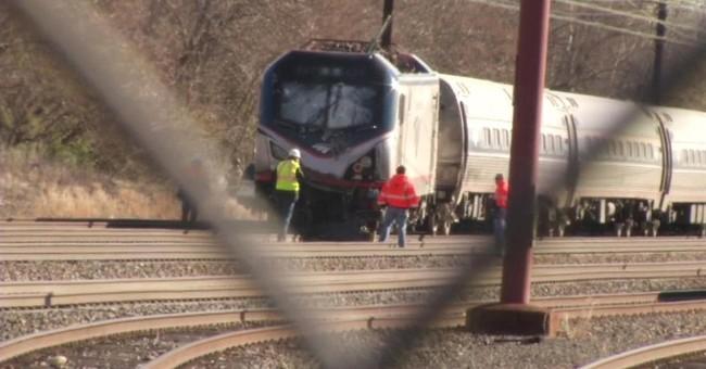 Officials: Amtrak engineer hit brakes seconds before crash