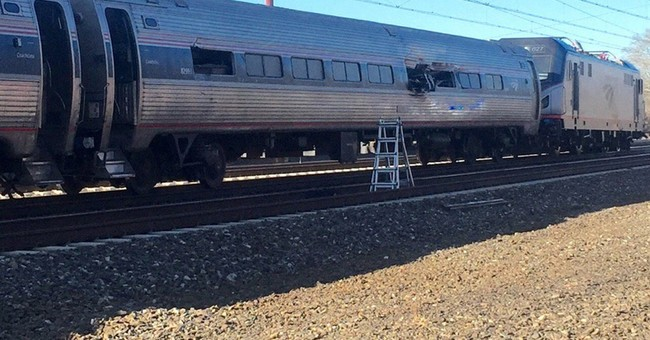 Amtrak train hits equipment on track; 2 workers die
