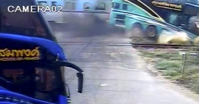 Train smashes into double-decker bus in Thailand, killing 3