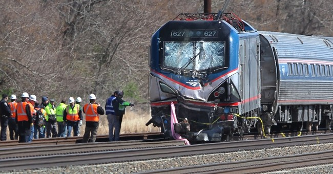 Amtrak train struck backhoe at 106 mph; 2 killed on track