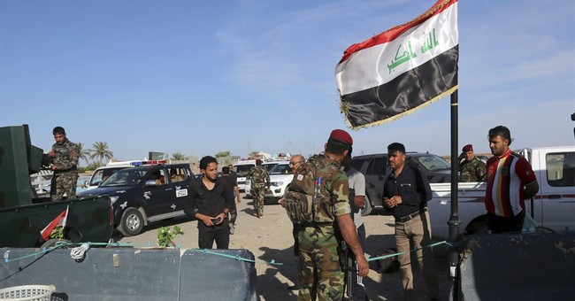 Wave of suicide attacks kill at least 29 people across Iraq