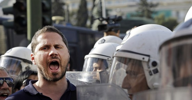 Greece, creditors resume bailout talks amid leak dispute