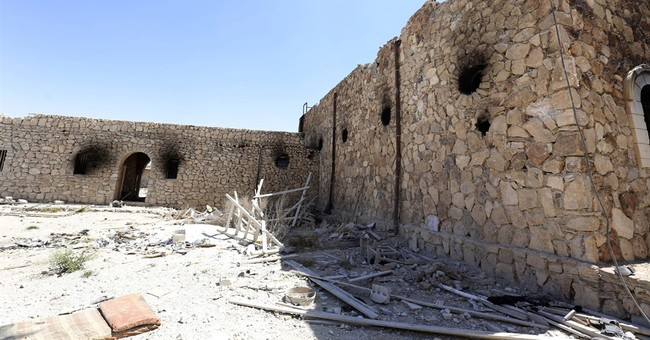 Destruction, razed monastery left behind by IS in Syria town
