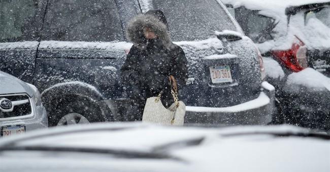 The Latest: New England spots break April 4 snowfall records
