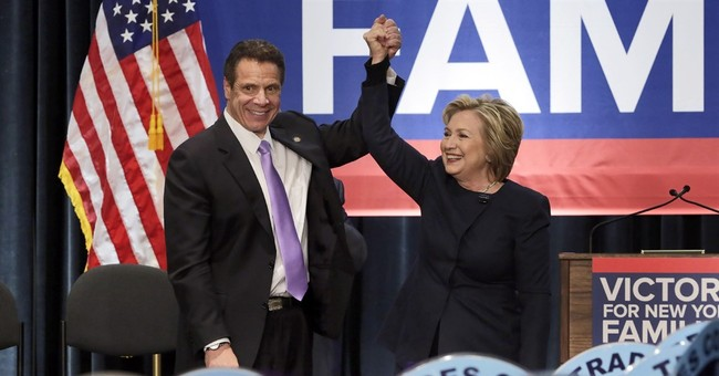 Clinton hails higher minimum wage in New York, California