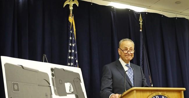 The Latest: Gun that looks like a phone causes a stir